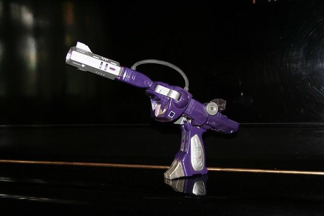 juguete pistola de rayos Shockwave Transformers
