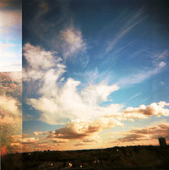 sky flies by (jeanamarieking) Tags: sky holga surreal away 120film cloads piratetreasure piratetreasure2