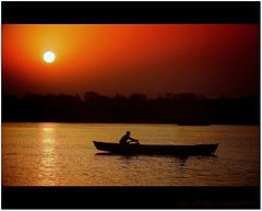 Soar...! Ganges river India (CyrusMafi) Tags: light sunset red sky orange india love yellow sunrise river hope boat heaven poetry shadows filter varanasi soar gangesriver sillhuette colorwater curusmafi