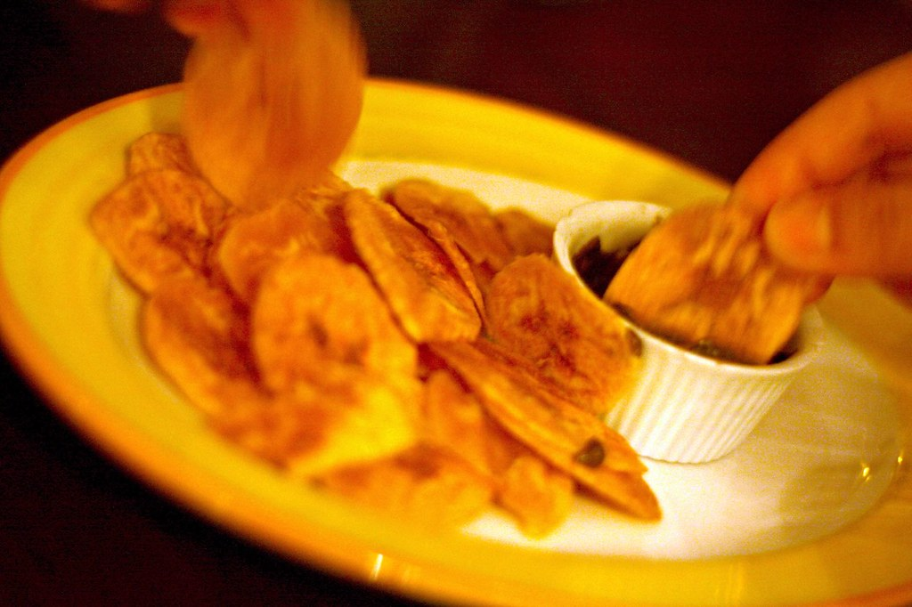Plantain chips with black bean dip