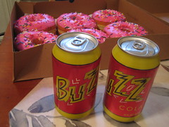 Buzz Cola and Red Sprinkleicious Donuts