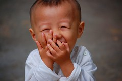 Baby Yao Number Three (Michael Steverson) Tags: china boy baby kids laughing nikon games laugh giggle chinadigitaltimes nikkor allrightsreserved yao guangxi expatriate liuzhou d40 passionphotography 25faves anawesomeshot aplusphoto superhearts feltlifepod happinessconservancy expatriategames