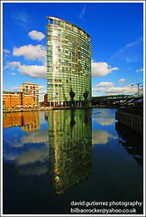 London City Reflecting Glass - Docklands (david gutierrez [ www.davidgutierrez.co.uk ]) Tags: road street city trip travel blue light vacation sky urban holiday color reflection building london tower art tourism glass lamp colors architecture modern clouds composition buildings wonderful point photography photo colours view angle image artistic cityhall weekend unique gorgeous sony awesome capital perspective picture cities cityscapes officebuilding wideangle pic structure architectural 350 future stunning excellent docklands unusual lovely alpha fabulous avenue dt municipality westindiaquay beautifulcolor f4556 1118mm flickrsbest outstandingshot amazingreflections 4morelondonriverside sonyalphadt1118mmf4556 architecturecanarywharf sony350dslra350