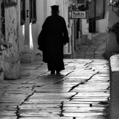 Priest (Frizztext) Tags: blackandwhite canon square blackwhite europe existentialism powershot explore santorini greece galleries christianity orthodox dictionary palabra 500x500 100faves flickrsbest powershota700 frizztext  2007615 thegardenofzen winner500 pocke