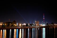 Toronto (Mortaric) Tags: toronto reflection water lights nikon cntower cne ferriswheel ontarioplace spotlights searchlights 18135 d40