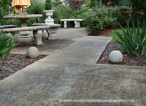 Patio. We Have These Concrete Balls Sporadically Placed Throughout The  Garden.