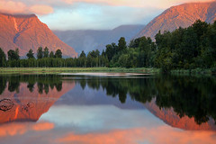 Lake Matheson (Daniel Murray (southnz)) Tags: park sunset newzealand mountain lake reflection landscape scenery national nz southisland westland matheson naturesfinest supershot specland abigfave colorphotoaward superaplus aplusphoto southnz superbmasterpiece taipoutini nz101lakematheson