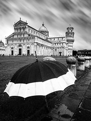 Motion over Pisa (Philipp Klinger Photography) Tags: world city italien light shadow sky bw italy white motion black blur tower heritage church grass rain clouds umbrella eu