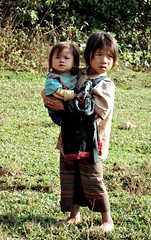 Striped Hmong village (Linda DV) Tags: travel people cute barn children geotagged kid asia southeastasia child young culture tribal clothes kind 1998 criana tribe laos ethnic minority enfant nio tribo stam indochine indochina ethnology dziecko tribu bambino stamm   ethnicminority  lapsi  copil dijete trib  dt trib  heimo minoritethnique  stamme  pokolenia stripedhmong minorit ethnischeminderheid  minderheid  lindadevolder  plemena pokolen     photonegativescan