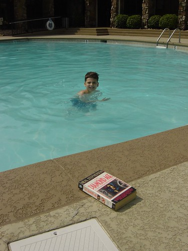 My son in the pool plus a good book (Diamond Age)
