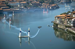 Red Bull reflections (trazmumbalde) Tags: show people portugal race speed plane reflections river landscape europe smoke air porto douro redbull serpentine daredevil stunt airrace nikonstunninggallery top20travelpix