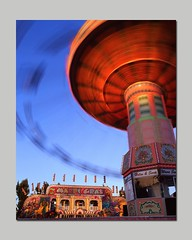Give it a Whirl! (RZ68) Tags: county carnival sunset summer cloud colors giant long exposure ride sonoma fair swing velvia human spinning rides 6x7 midway tornado provia swinger funnel chairoplanes e100 rz68
