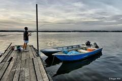 Patience.. (Reggie Wan) Tags: seascape boats pier fishing singapore southeastasia jetty hdr limchukang sonya700 sonyalpha700 reggiewan