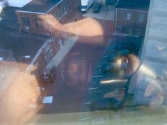 the new face of DC (redjoe) Tags: morning blue light sky hairy sun black reflection eye me window glass leather buildings hair fur beard ginger washingtondc dc furry view apartment floor mask redhead penthouse redhair reflexions logancircle layingdown redjoe joehorvath