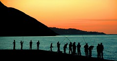 Mackeral Sunset (shaymurphy) Tags: ocean ireland sunset sea people irish mountain fish silhouette pier fishing fisherman europa europe fishermen greystones irland eire wicklow silhoette soe irlanda irlande      flickrsbest 35faves  shieldofexcellence aplusphoto superbmasterpiece postcardoftheweek wowiekazowie excellentphotographerawards platinumheartaward theperfectphotographer ostrellina