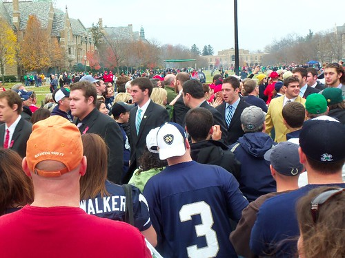 The Notre Dame football team marches to the stadium after Mass.