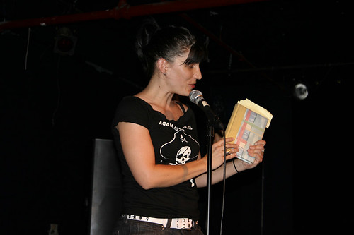 on stage reading goth poetry to a full house
