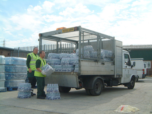 Cheltenham Borough Council staff loading up bottled water