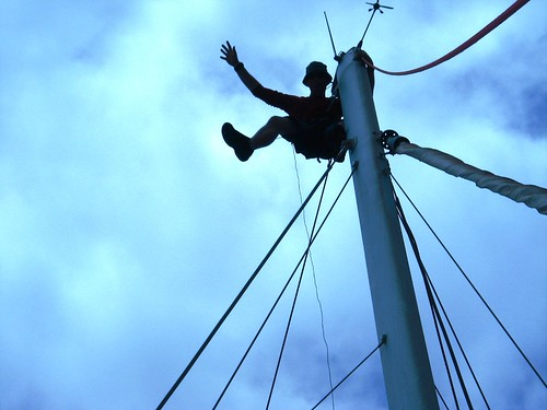 The joys of being a crew member - hoisted up the mast to check rigging (San Miguel, Tenerife, Canary Islands)
