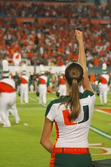 One of the flag girls from the Band of the Hour (dave_teems) Tags: canes collegefootball miamihurricanes noles theu floridastateseminoles