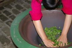 This little lady moved the tea and formed a ball out of the leaves: the large bowl is a pan and is very hot: 450 degrees.  we watched her then went in for the chinese tea ceremony