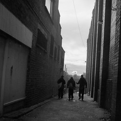 Alley Boys (the underlord) Tags: street people tlr mediumformat town blackwhite market hometown candid saturday lancashire negativescan 100asa lowsun yellowfilter lateafternoon twinlensreflex ormskirk selfdeveloped bsquare epson4490 kodakd76 shanghaigp3 curlynegs believeinfilm