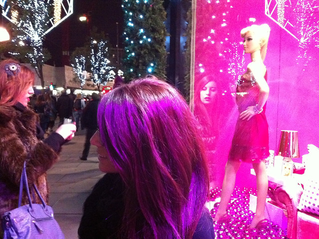 Life size Barbie mannequin and women in the street