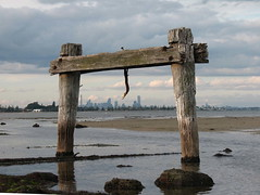 Melbourne view through the old jetty at Altona (debzhouse) Tags: beach melbourne altona oldjetty