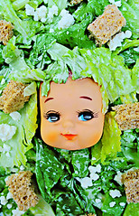 Caesar Sally (2) (boopsie.daisy) Tags: food silly cute green strange weird salad yummy crazy eyes doll pretty eyelashes peekaboo caesar dressing sally odd lettuce leafy quirky feta croutons dollhead kooky dollface caesarsalad fetacheese headoflettuce