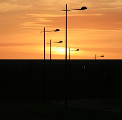jupiter rising (limerickdoyle) Tags: sunset shadow orange energy perspective lamppost orangesky jupiter canon400d
