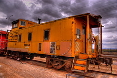Rio Grande Yellow Caboose (Thad Roan - Bridgepix) Tags: railroad red arizona brown color phoenix yellow museum clouds train rust colorful track steel gray rusty rail railway caboose wikipedia chandler traintrack railfan hdr railfanning photomatix drgw 200702 denverriograndewesternrailroad arizonarailwaymuseum riogranderailroad photo2c21