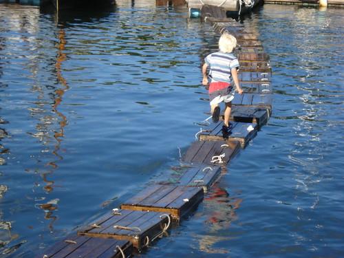 boy running on lobster traps