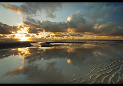 Wind and water, Explore frontpage (Ianmoran1970) Tags: blue sunset sea sky irish orange cloud sun wet reflections river landscape sand boots alt explore fp frontpage mersey windfarm crosby muddyboots explored ianmoran ianmoran1970