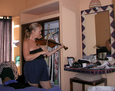 Sylvia practices the violin