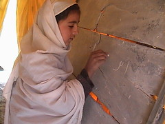 Afghani School Girl at Chalkboard