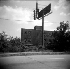 warehouse (BoringPostcards) Tags: atlanta bw blur 120 film monochrome georgia holga shanghai billboard warehouse sales