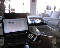 Sony laptop and Apple iPhone on a floating house.