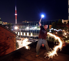 this was supposed to be a rock star pose (scienceduck) Tags: longexposure 15fav selfportrait toronto ontario canada rooftop me public night wow lights cntower july wideangle moi slowshutter sparkler tdot 2007 scienceduck