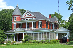 Queen Anne (Texas Finn) Tags: windows red white house detail architecture concrete texas palestine balcony steps victorian historic driveway porch mansion railing posts trim screens carport gable preservation porches portecochere wraparound wellmaintained