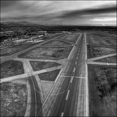 A Matter of Perspective (ecstaticist) Tags: city winter urban blackandwhite bw white canada black window grass vancouver photoshop canon airport angle conversion delta line landing helicopter commute converted guide curve yvr takeoff runway flyover asphault flyby helijet photomatix tonemapped g10