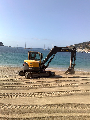 Mini-digger makes more beach
