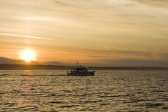 Heading In (Phil Peck) Tags: seattle sunset vacation orange sun reflection water clouds boat naturesfinest ishflickr