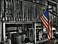 Old Glory, Old Porch (OtisDude) Tags: usa photoshop michigan flag patriotic rochester american hdr oldglory selectivecolor singleraw oldporch ef2035