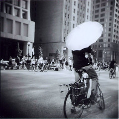 (littlepretty) Tags: chicago bike bicycle umbrella holga lomo downtown basket onelesscar criticalmass bikesarefun daleyplaza blackandwhitechicago