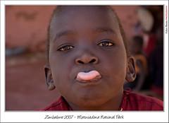 (brettocop) Tags: africa face tongue children village zimbabwe