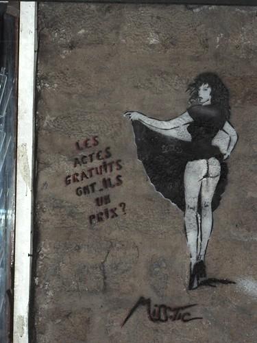 Paris street art by Miss Tic graces a wall near Rue Mouffetard.