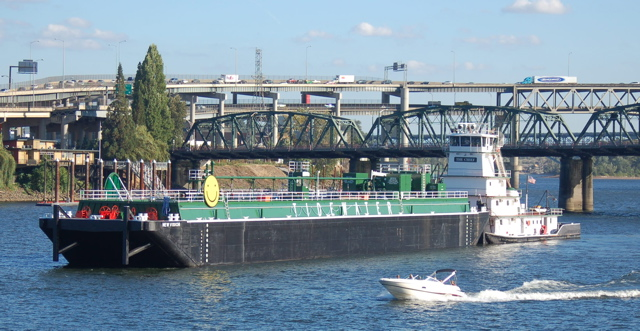 The green metal struss bridge is the Hawthorne Bridge, and the double deck ...