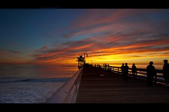 twilight (Eric 5D Mark III) Tags: ocean california sunset sky people cloud seascape color reflection beach silhouette canon fence landscape pier twilight weekend perspective dramatic wave atmosphere wideangle orangecounty sanclemente tone ef1635mmf28liiusm eos5dmarkii
