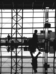 airport (jovivebo) Tags: blackandwhite bw reflection blancoynegro topf25 silhouette top20bw gate europa europe belgium belgique belgie noiretblanc pb bn pretoebranco biancoenero flanders aiport zaventem blancinegre luchthaven vlaanderen flandre vlaamsbrabant