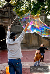 Bubble Performer, Central Park (amycicconi) Tags: girls ny newyork girl children happy photo nikon child centralpark bubbles pop bubble streetperformer d200 bethesdaterrace giantbubbles bubblesoap poppingbubbles amystrycula largebubble largebubbles popabubble